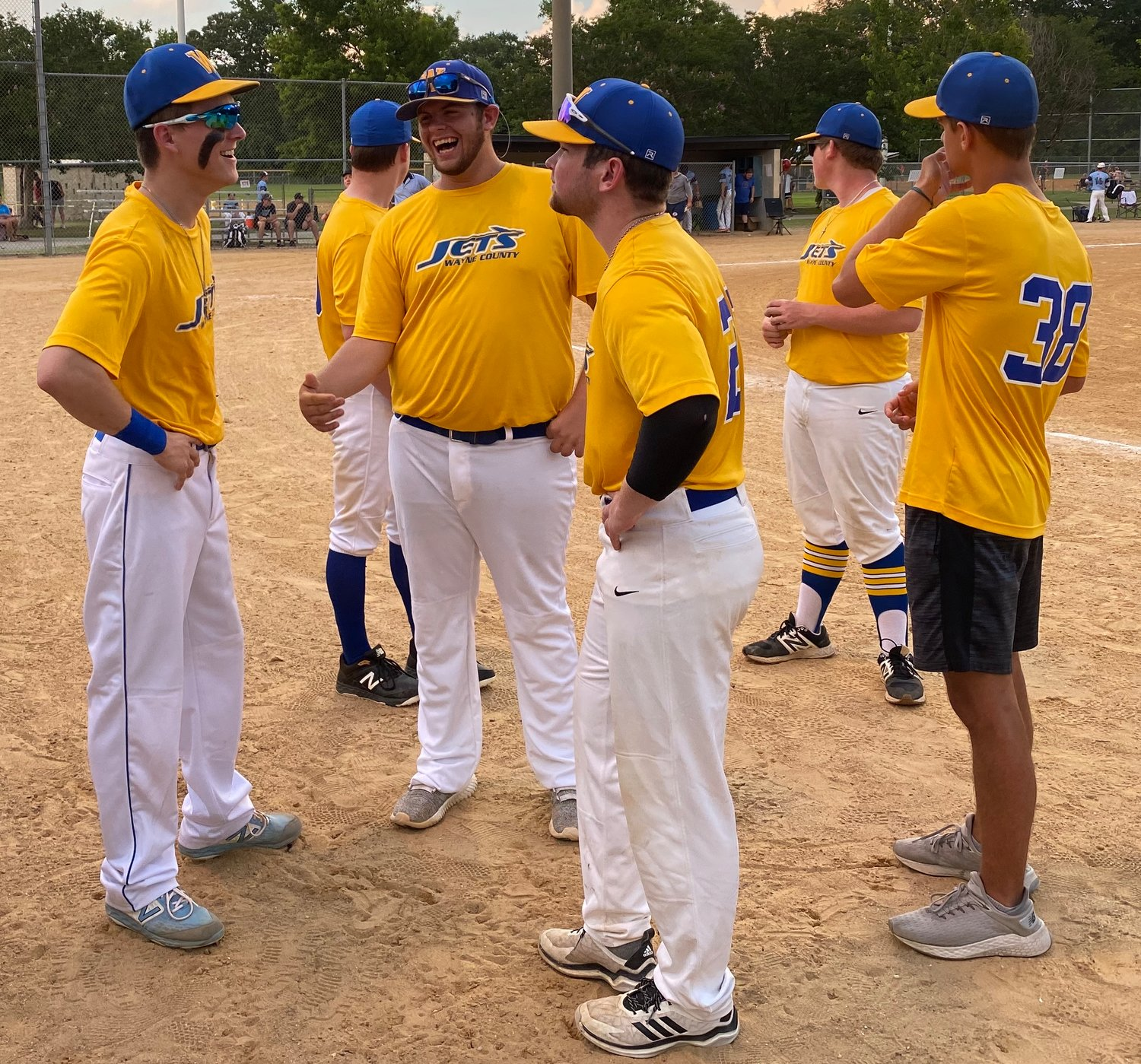 Wayne County Jets players talk before their game against the Garner Nationals on Monday evening.