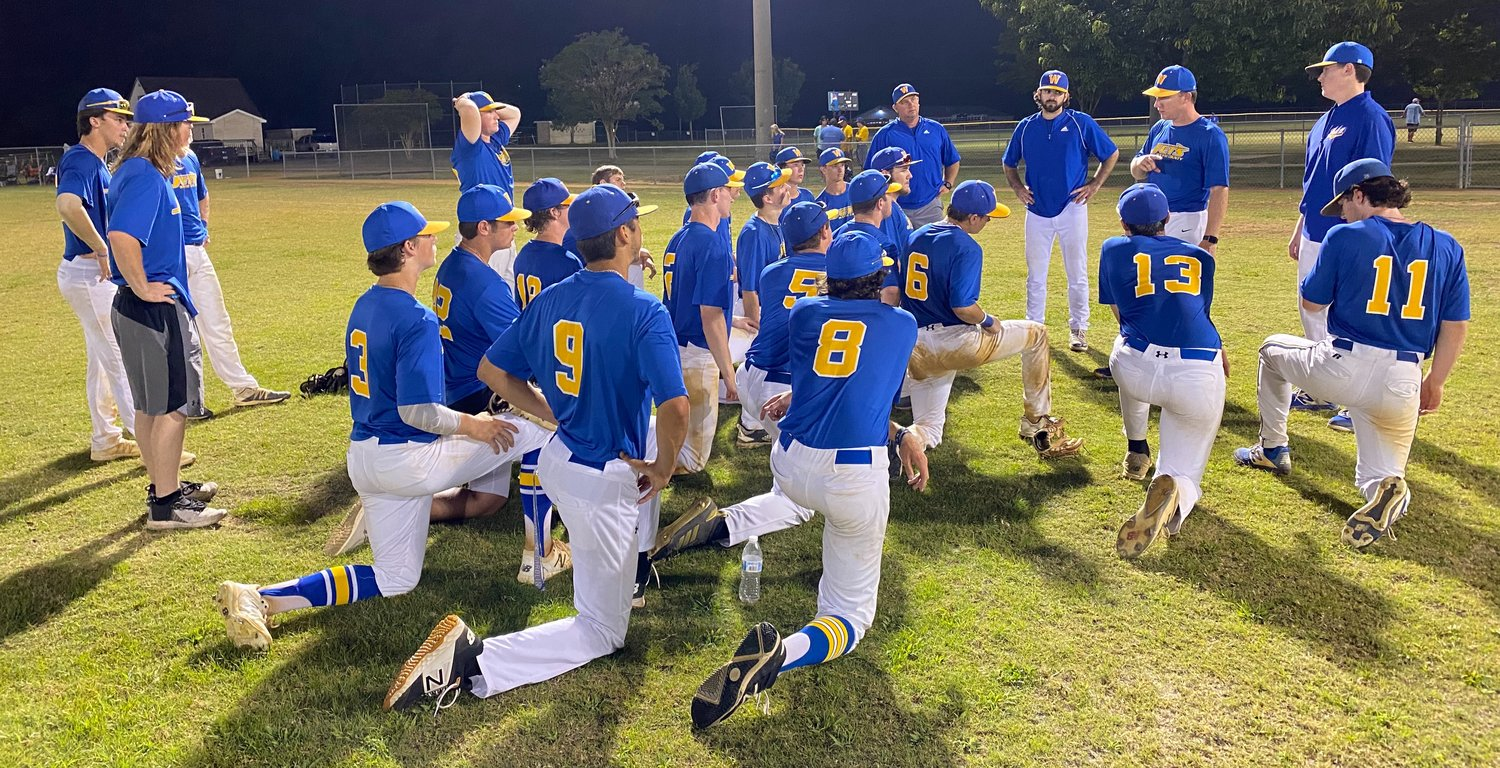 Wayne County Jets players listen to the coaching staff an 11-0 victory over Cary on Monday evening at the Eastern Carolina Athletic Park.