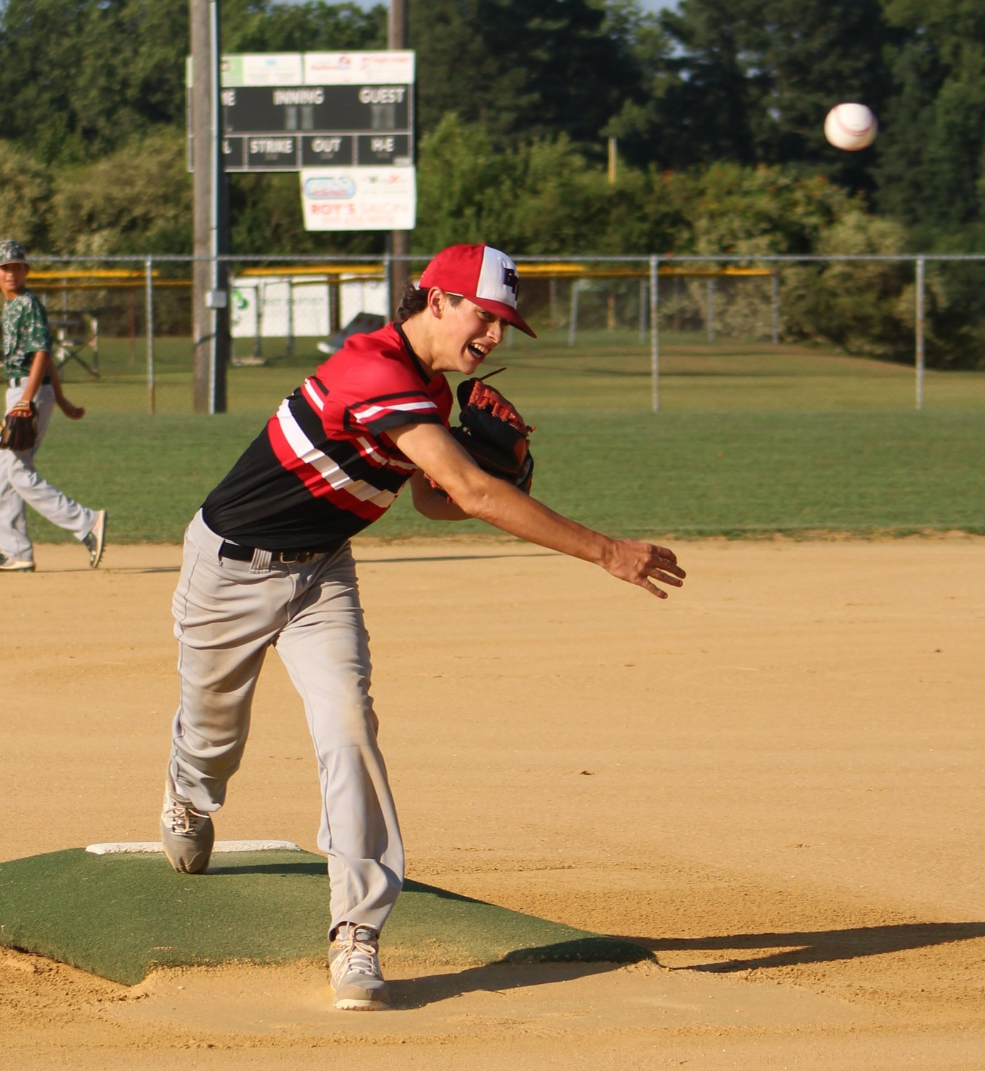Mount Olive Green Machine right-hander Richard Noble fires a pitch toward the plate during a recent outing. Noble emerged as the winning pitcher in Mount Olive's come-from-behind, 6-3 conquest of the Garner Junior Nationals on Tuesday evening.
