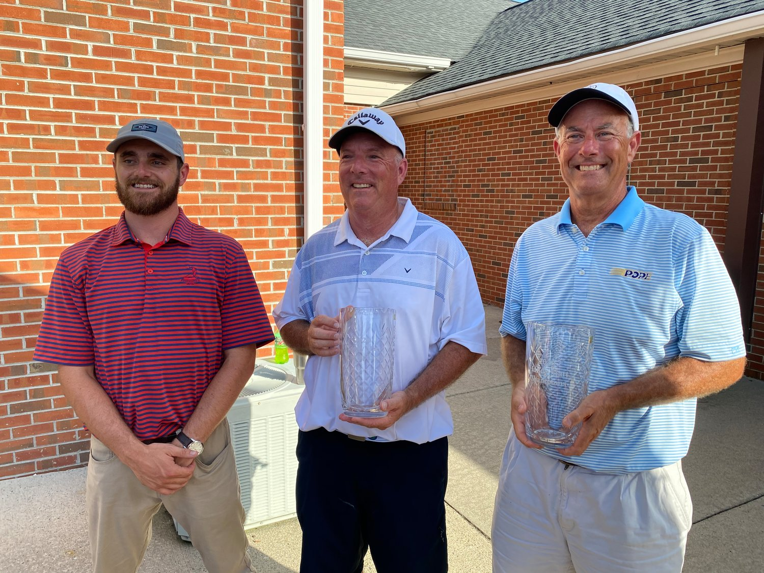 Troy Herring (center) and Judson Pope (right) claimed the Championship Flight and two crystal vases during the Southern Wayne Country Club Handy Mart Tournament contested this past weekend. Standing with Herring and Pope is Kyle Best, golf pro at SWCC.