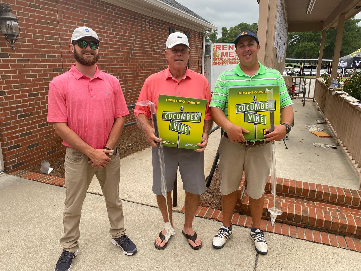 John Zambelli, center, and playing partner Jonathan Burke, right, teamed up to win the 52nd annual Pickle Classic contested at Southern Wayne Country Club this weekend. Pictured with the title-claiming duo is SWCC Golf Pro Kyle Best.