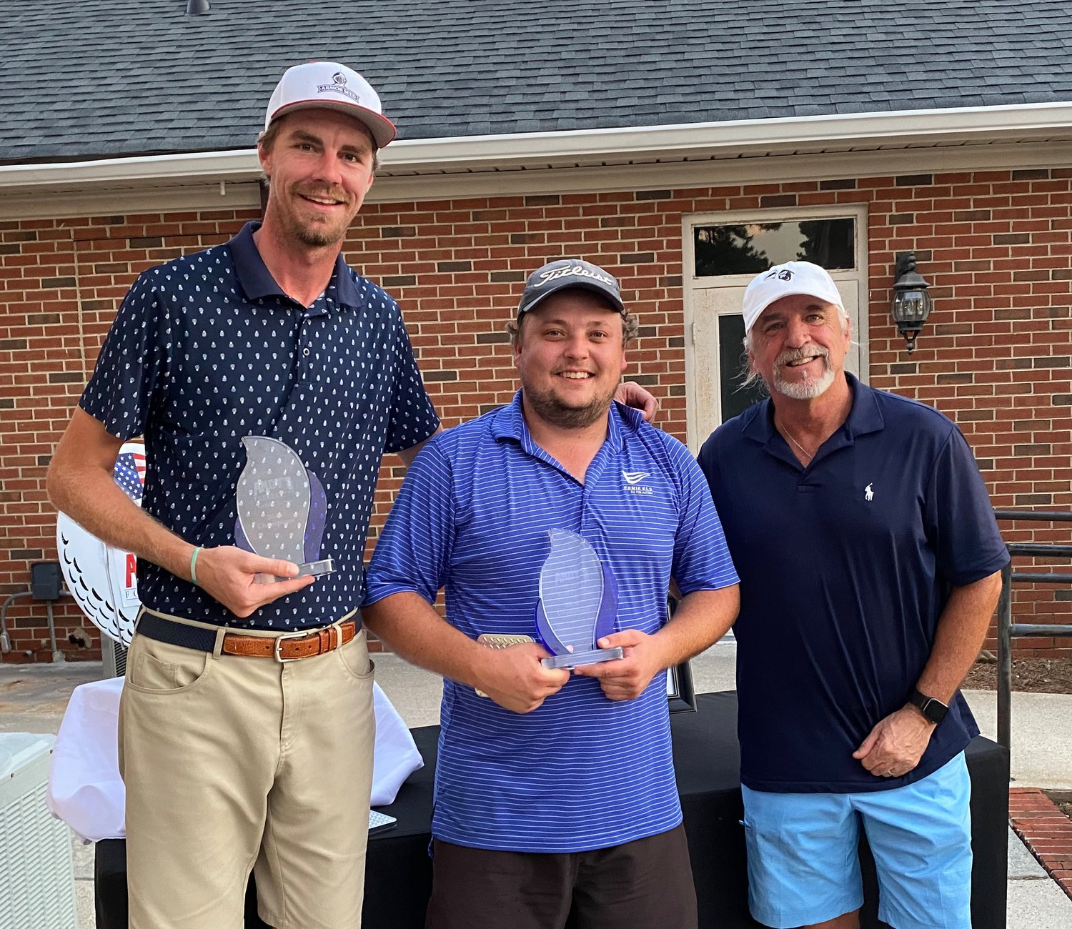 Eric Williams (left) and Will Caughron (right) claimed the 2020 Andy's Foundation Golf Classic title in a one-hole playoff at Southern Wayne Country Club on Sunday evening. Standing with Williams and Caughron is Kenney Moore, founder and CEO of Highway 55 Burgers, Shakes and Fries.