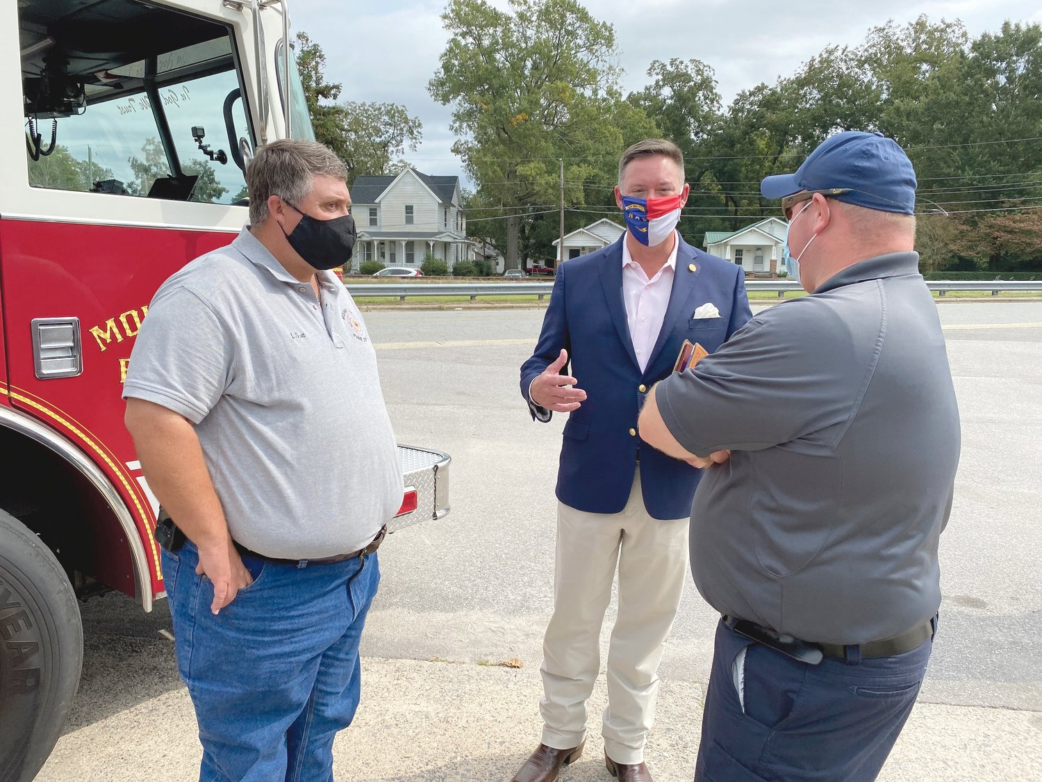Mount Olive Fire Department Assistant Chiefs Jonathan Scott, left, and Jordan Hansen, right, talk with Robert Hosford, North Carolina director for USDA Rural Development.