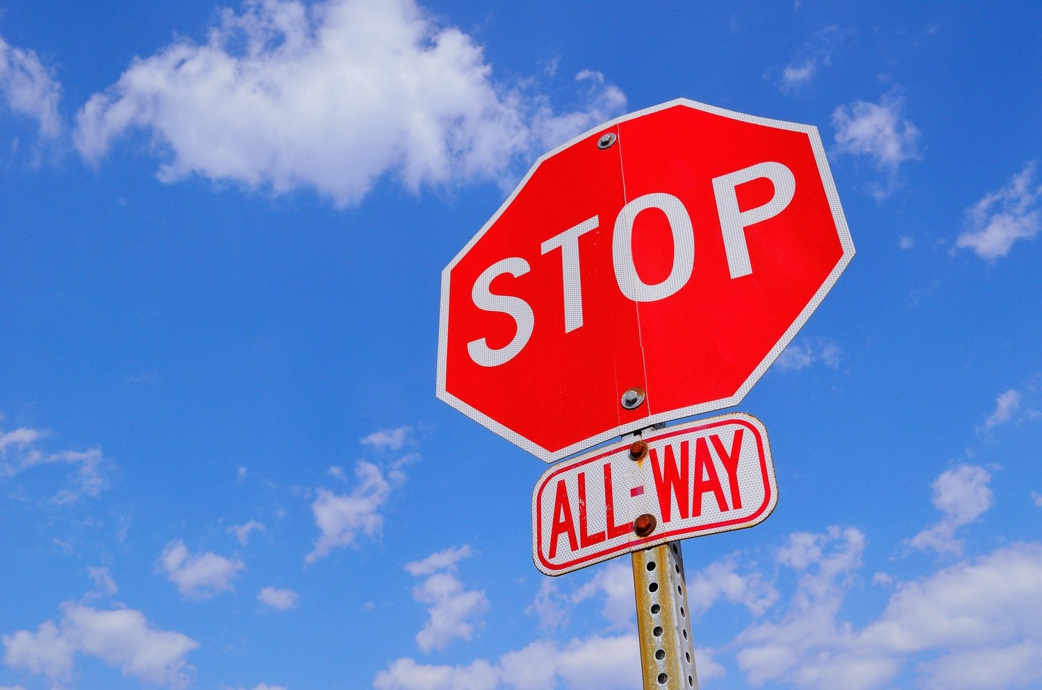 An all-way stop is coming to an intersection on Old Mount Olive Highway.