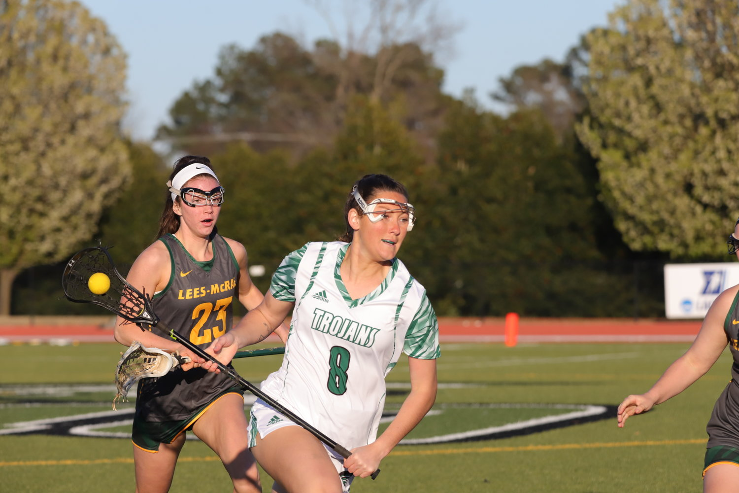 University of Mount Olive midfielder Ali Davis (8) keeps control of the ball during a match last year. The Trojans are ranked No. 2 in the Conference Carolinas women's lacrosse preseason poll.
