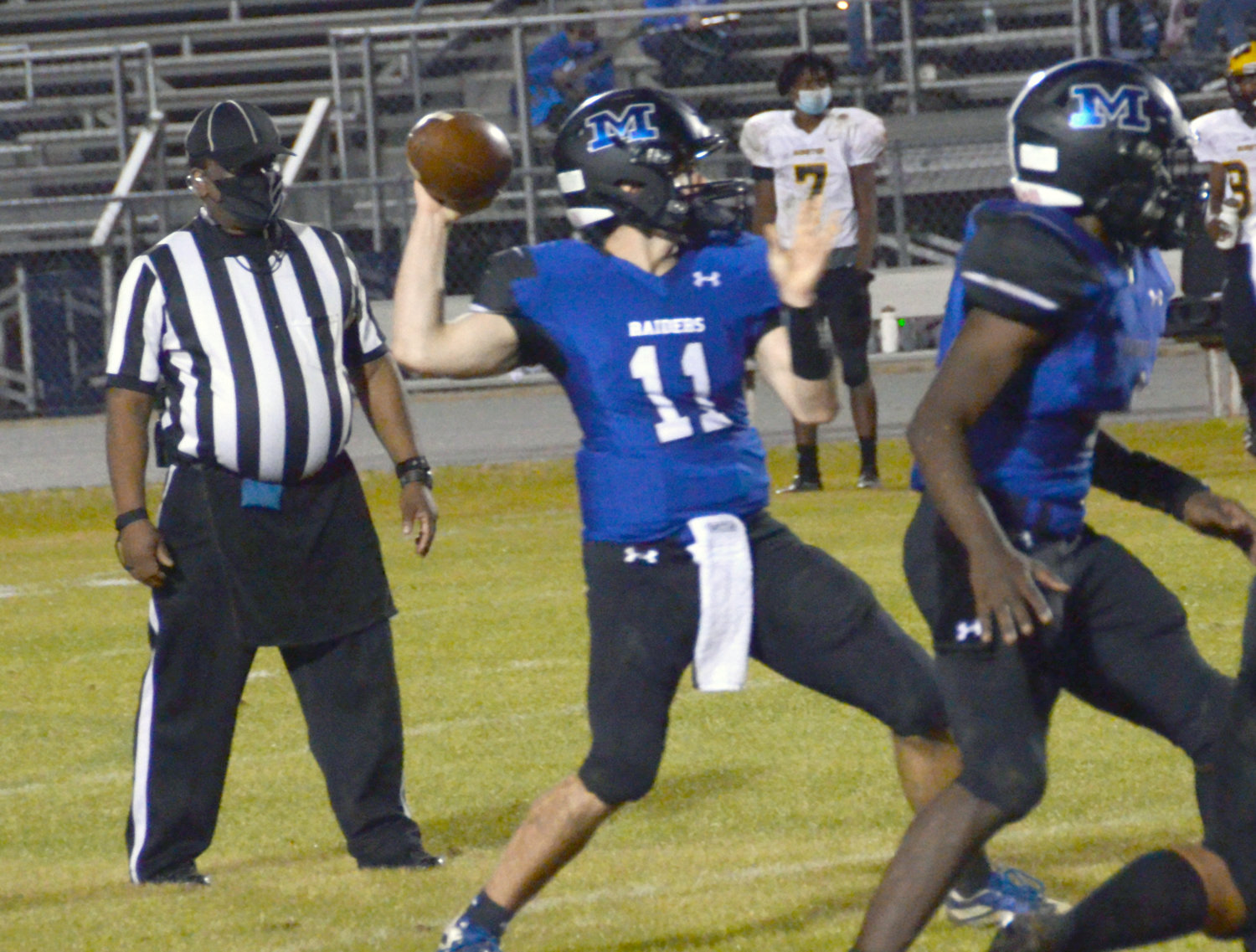 Wyatt Holland (11) totaled a career-high 300 yards passing to help Midway down rival Hobbton during last Thursday's opener in Spivey's Corner.