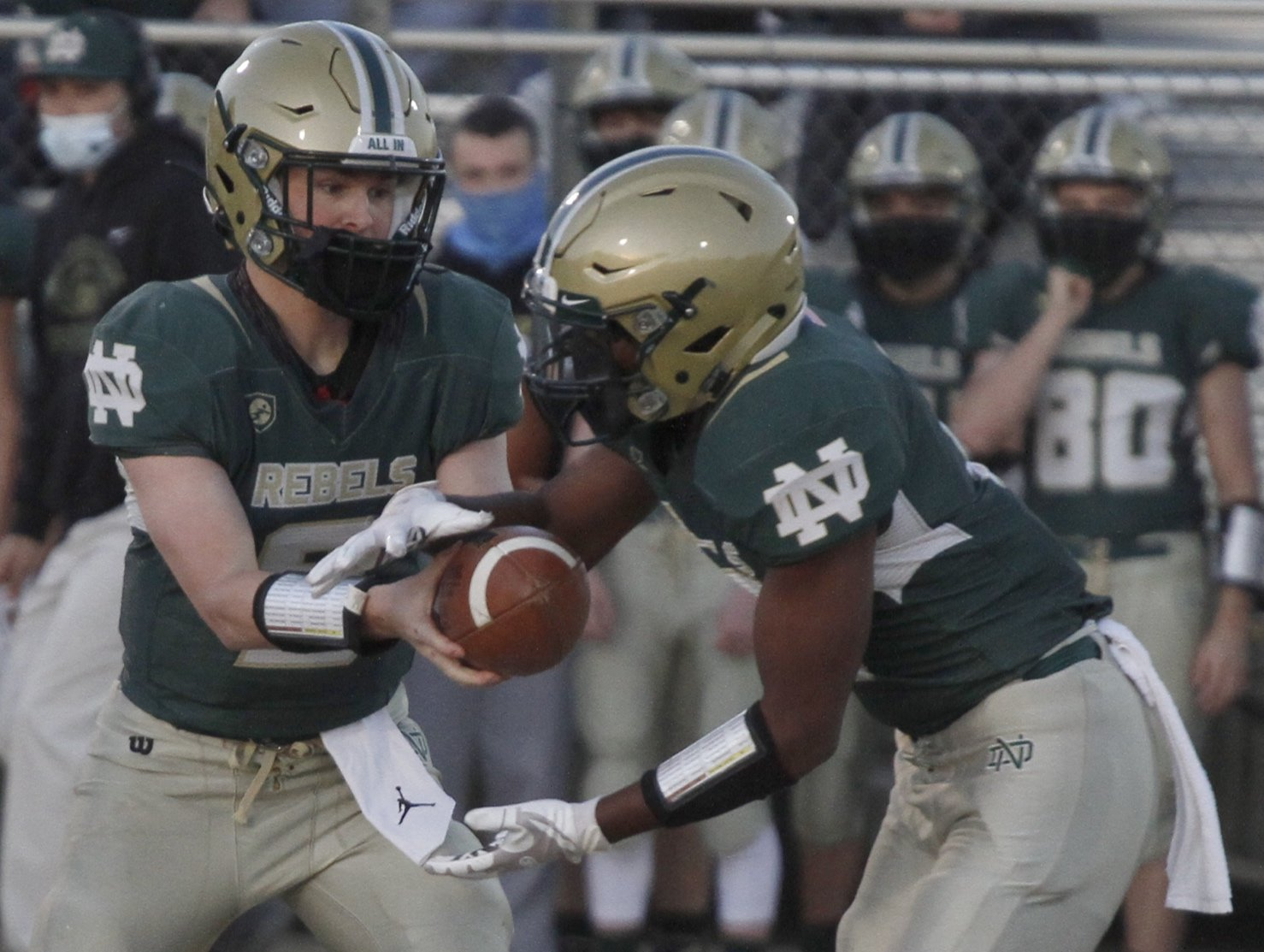 North Duplin quarterback Gage Outlaw (left) hands the ball off to freshman running back DuJuan Armwood on the first play from scrimmage during their game against Jones Senior on Thursday evening. Armwood rushed for 169 yards in the Rebels' 49-16 victory.