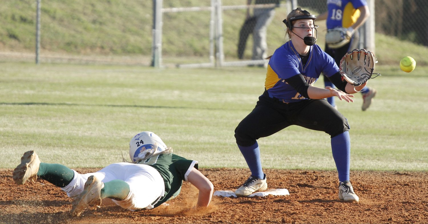 North Duplin's Kasey Jones (left) slides toward second base as Princeton shortstop Kaydon Roberson fields the throw during their Carolina 1A softball game in Calypso on Monday evening.