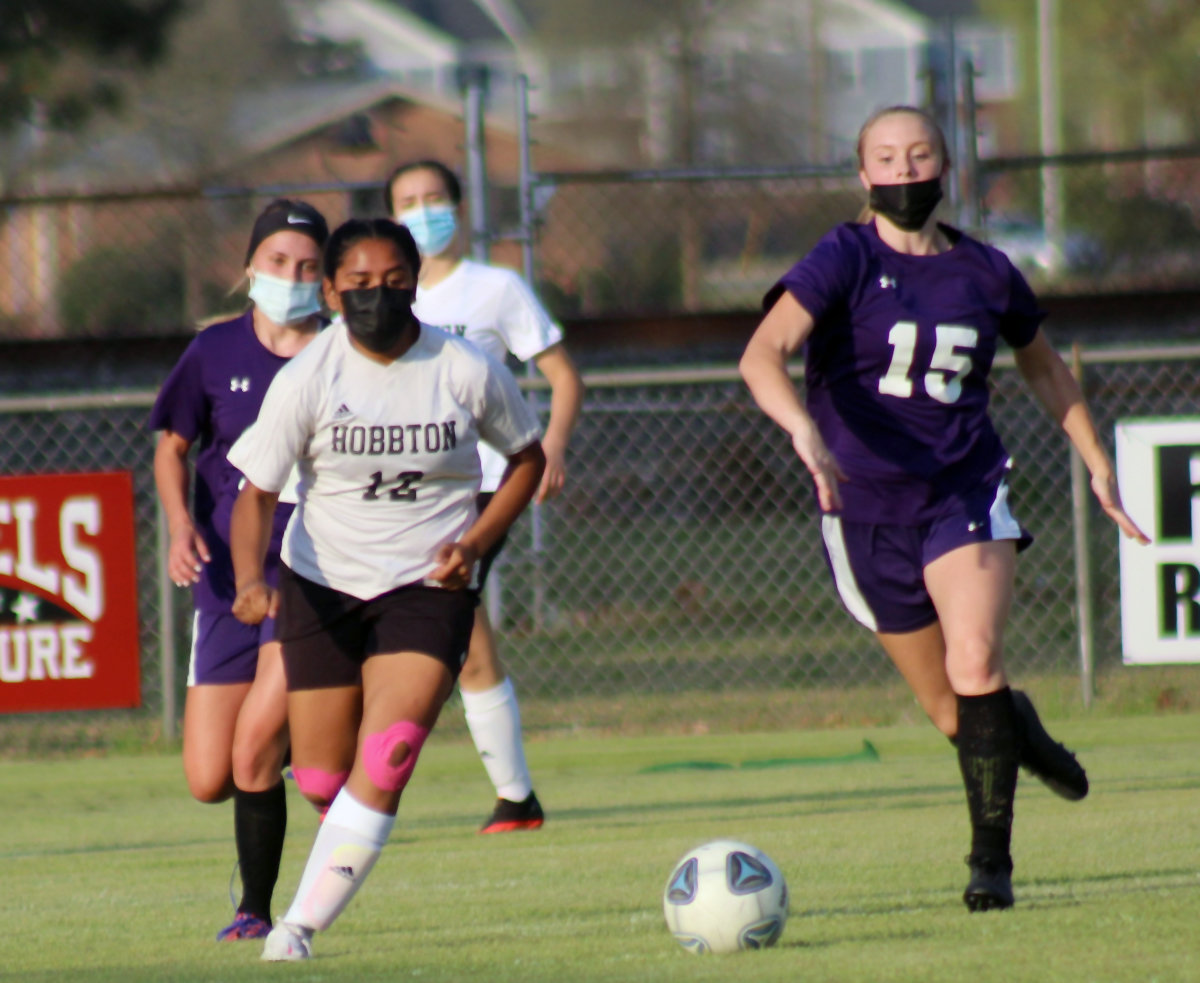 Hobbton's Mireya Ramirez, left, runs towards the ball against a Rosewood defender during the 3-2 road win Tuesday.