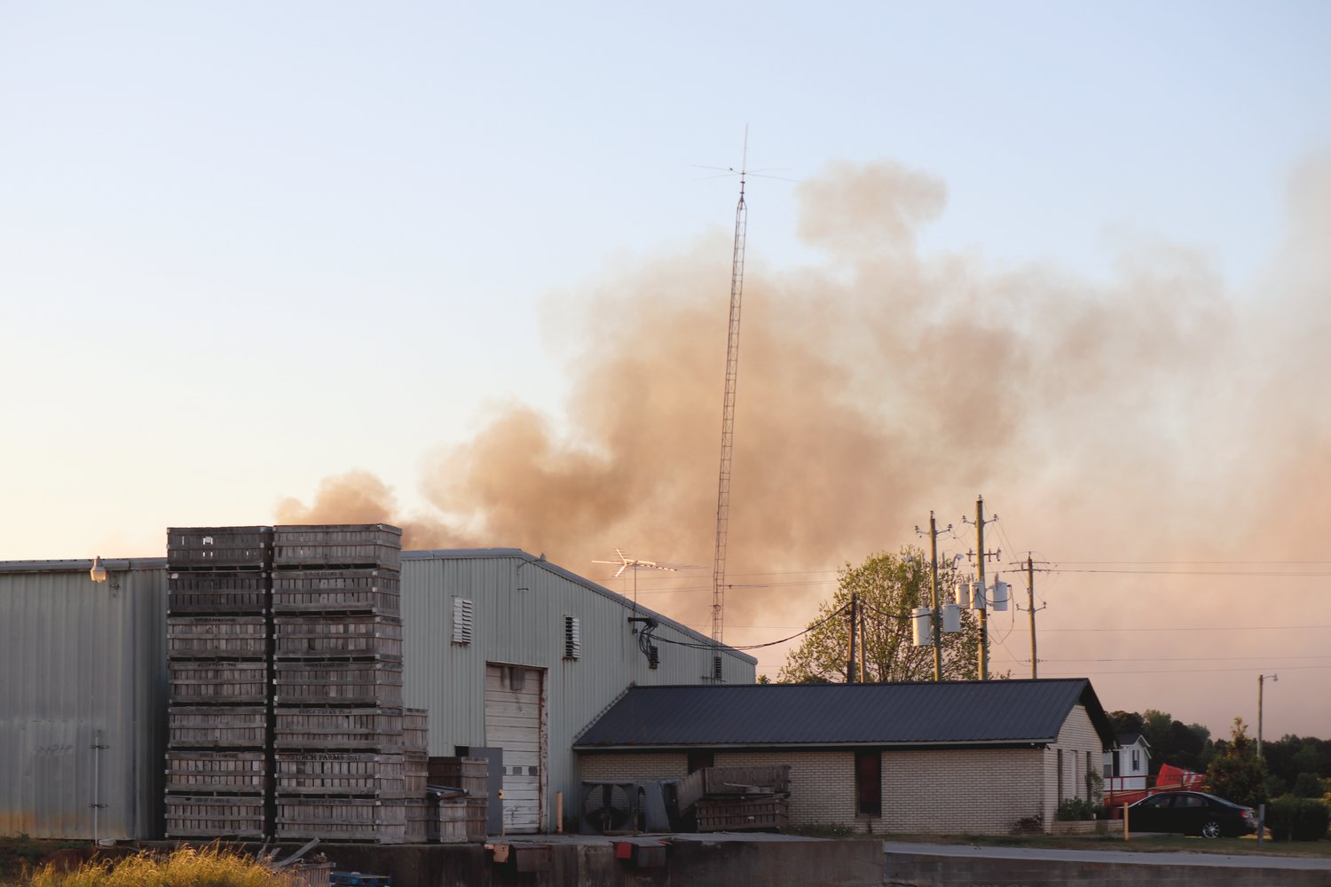 Heavy smoke fills the air around the Enviva Pellet Plant in Sampson County Friday.
