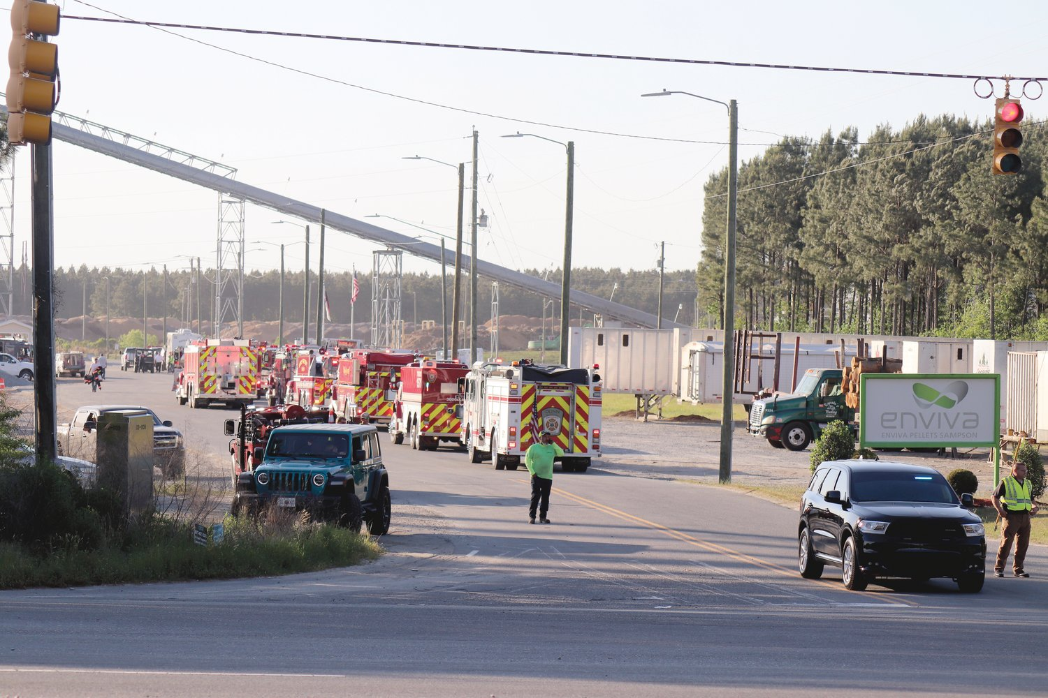 Firefighting crews from multiple counties and the N.C. Forestry Service work to extinguish a blaze at the Enviva Pellet Plant in Sampson County Friday evening.