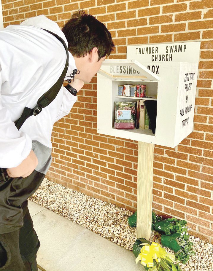 Southern Wayne senior Paul van Dyke looks inside the blessings box he and his fellow Boy Scouts from Faison Unit 48 built at Thunder Swamp Church. Van Dyke earned his Eagle Scout badge once he passed the review board.