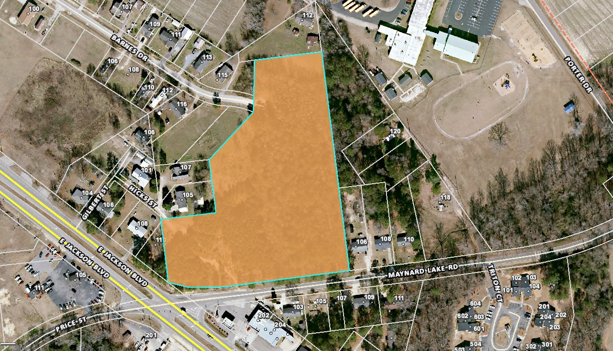 The shaded parcel, pictured here, is where developers plan to put a 64-unit apartment complex in Erwin, off of Maynard Lake Road. Erwin Elementary at Gentry can be seen to the top right of the parcel and the Triton Mart is the grey building located beneath it.