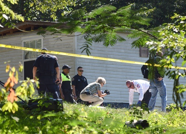 Investigators and emergency personnel work the scene of a fatal shooting on Scenic Drive in Cookeville Thursday afternoon.