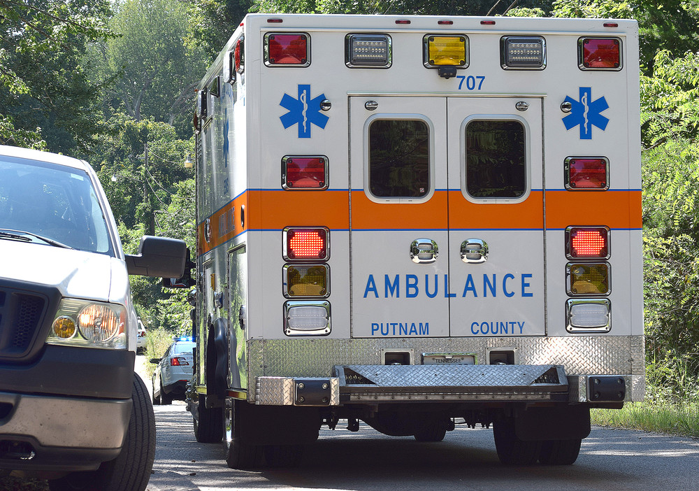 A Putnam Ambulance Service ambulance leaves the scene of a fatal shooting on Scenic Drive in Cookeville Thursday.