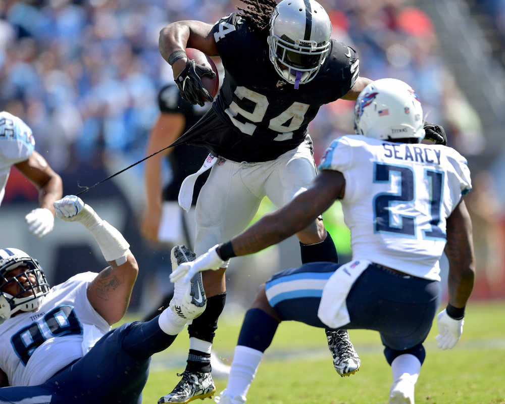 Raiders running back Marshawn Lynch (24) eludes Titans defensive end Jurrell Casey (99) in the second half of the Oakland Raiders at Tennessee Titans NFL football game on Sept. 10, 2017, at Nissan Stadium in Nashville, Tenn. Raiders won 26-16. (Photo by Lee Walls)