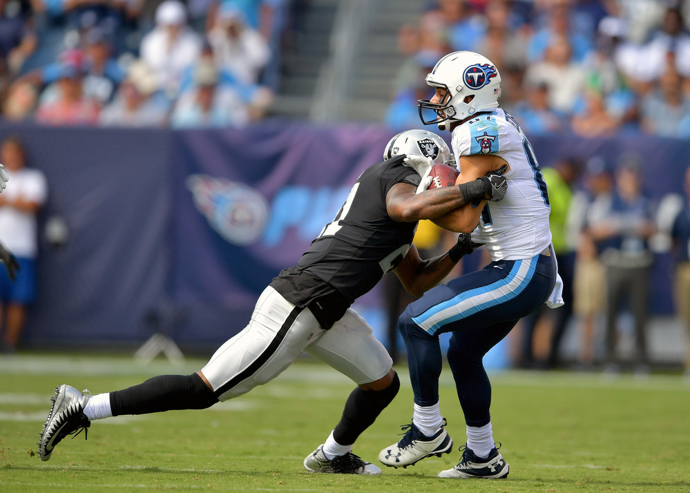 Raiders cornerback Sean Smith (21) tries to bring down Titans wide receiver Eric Decker (87) during the second half of the Raiders at Titans NFL football game on Sept. 10, 2017, at Nissan Stadium in Nashville, Tenn. Raiders won 26-16. (Photo by Lee Walls)