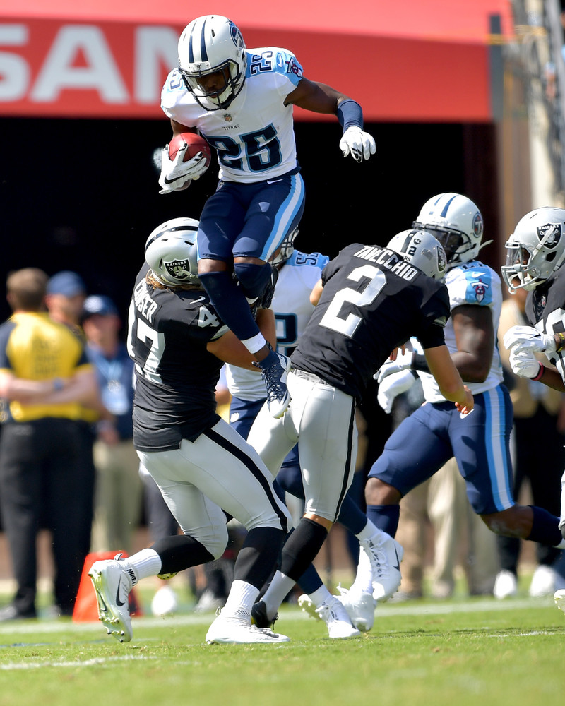 Titans punt returner Adoree' Jackson (25) makes an incredible leap trying to avoid Raiders defensive end James Cowser (47) in the second half of the Raiders at Titans NFL football game on Sept. 10, 2017, at Nissan Stadium in Nashville, Tenn. Raiders won 26-16. (Photo by Lee Walls)