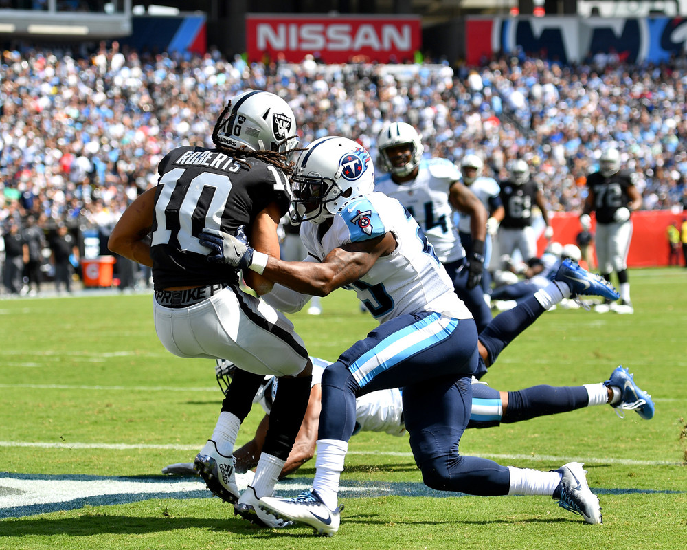 Titans cornerback Adoree' Jackson (25) tries to block a pass to Raiders wide receiver Seth Roberts (10) in the end zone during the second half of the Oakland Raiders at Tennessee Titans NFL football game on Sept. 10, 2017, at Nissan Stadium in Nashville, Tenn. Raiders won 26-16. (Photo by Lee Walls)