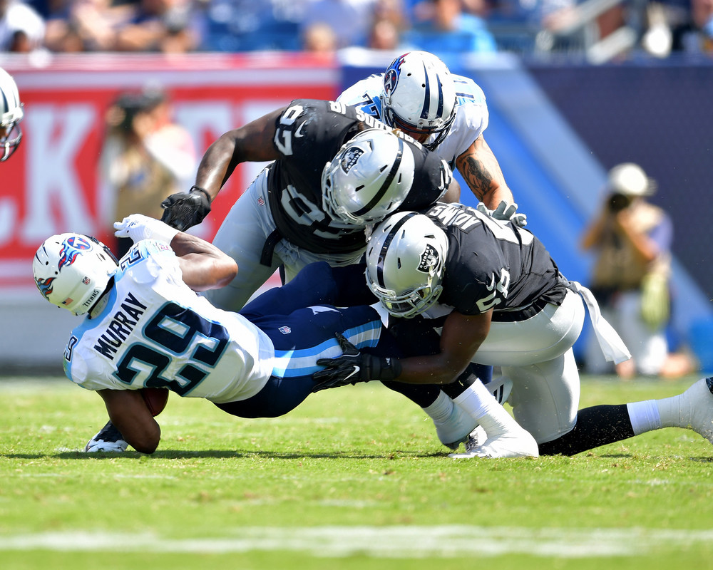 Titans running back DeMarco Murray (29) is brought down in the second half of the Oakland Raiders at Tennessee Titans NFL football game on Sept. 10, 2017, at Nissan Stadium in Nashville, Tenn. Raiders won 26-16. (Photo by Lee Walls)