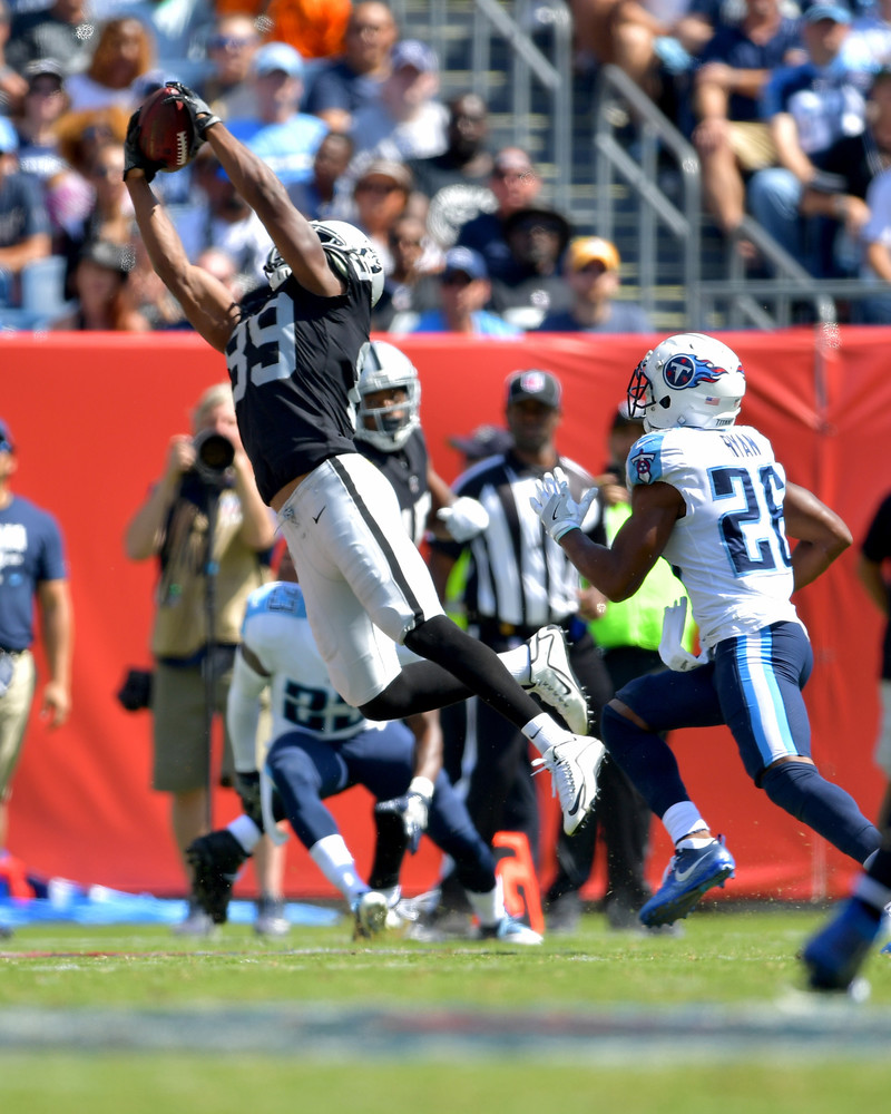 Titans defensive back Logan Ryan (26) can't stay with Raiders wide receiver Amari Cooper (89) as Cooper makes a catch in the second half of the Raiders at Titans NFL football game on Sept. 10, 2017, at Nissan Stadium in Nashville, Tenn. Raiders won 26-16. (Photo by Lee Walls)