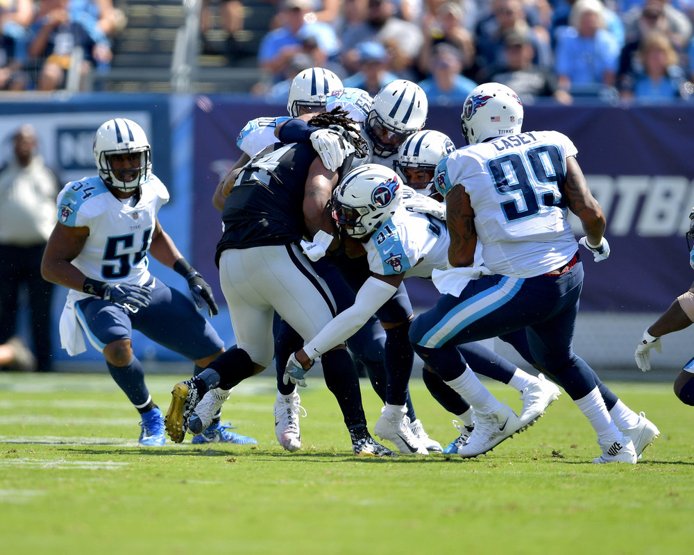 Almost half of the Titans defense tries to tackle Raiders running back Marshawn Lynch (24) during the second half of the Raiders at Titans NFL football game on Sept. 10, 2017, at Nissan Stadium in Nashville, Tenn. Raiders won 26-16. (Photo by Lee Walls)