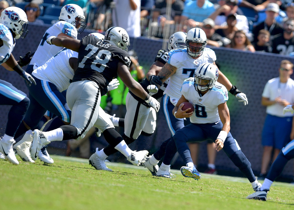 Titans quarterback Marcus Mariota (8) scrambles on a keeper in the second half of the Oakland Raiders at Tennessee Titans NFL football game on Sept. 10, 2017, at Nissan Stadium in Nashville, Tenn. Raiders won 26-16. (Photo by Lee Walls)