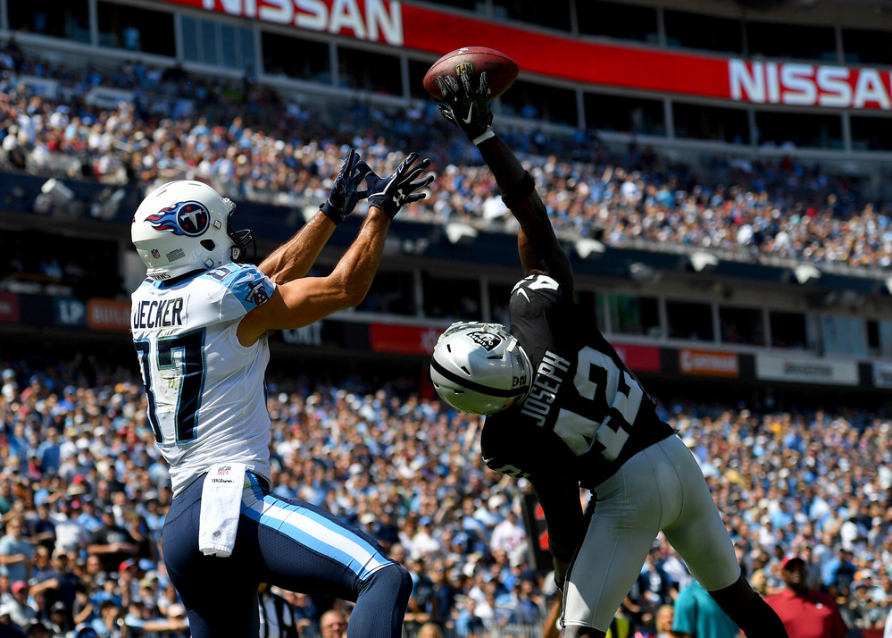 Raiders strong safety Karl Joseph (42) breaks up a pass intended for Titans wide receiver Eric Decker (87) in the first half of the Raiders at Titans NFL football game on Sept. 10, 2017, at Nissan Stadium in Nashville, Tenn.