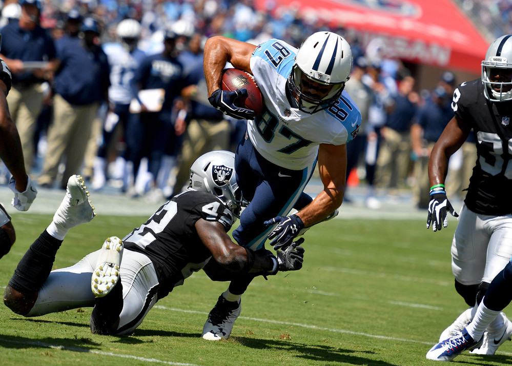 Titans wide receiver Eric Decker (87) tries to escape a tackle in the first half of the Oakland Raiders at Tennessee Titans NFL football game on Sept. 10, 2017, at Nissan Stadium in Nashville, Tenn.