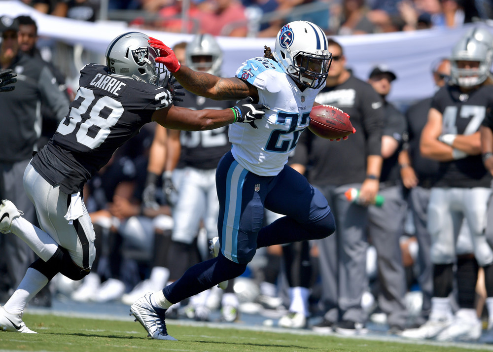 Titans running back Derrick Henry (22) on a carry in the first half of the Oakland Raiders at Tennessee Titans NFL football game on Sept. 10, 2017, at Nissan Stadium in Nashville, Tenn.