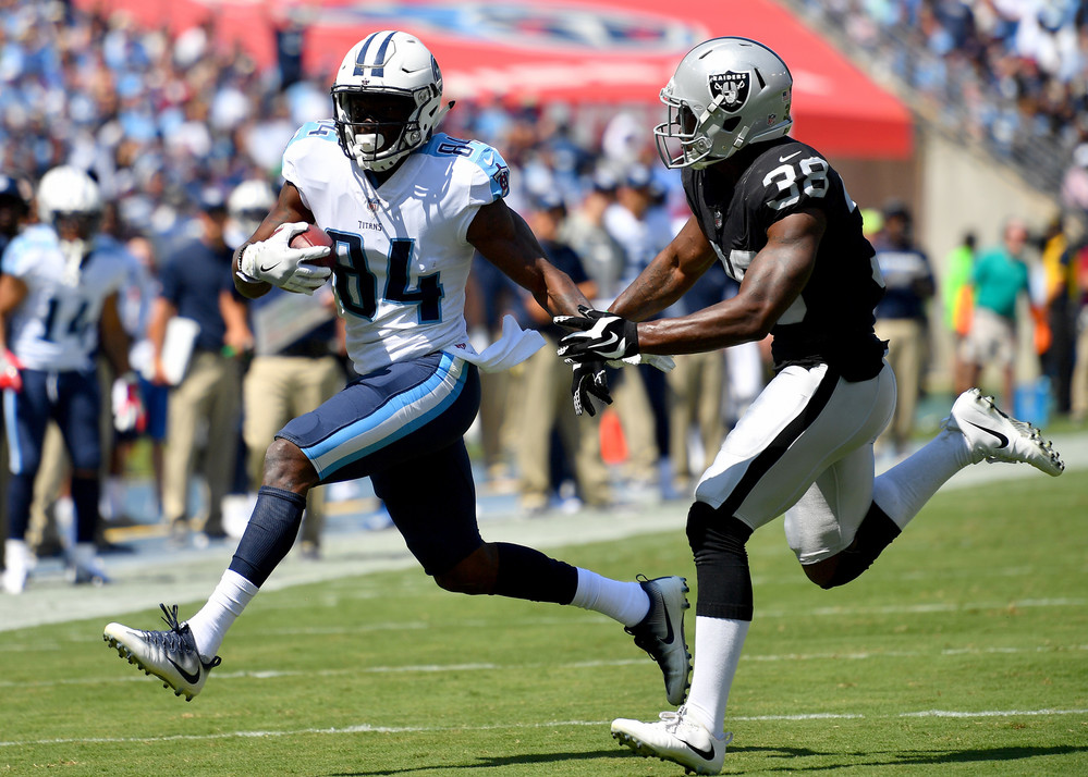 Titans wide receiver Corey Davis (84) on a run after a reception in the first half of the Oakland Raiders at Tennessee Titans NFL football game on Sept. 10, 2017, at Nissan Stadium in Nashville, Tenn.