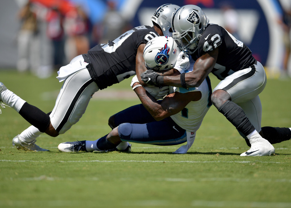Titans wide receiver Corey Davis (84) is tacked during the first half of the Oakland Raiders at Tennessee Titans NFL football game on Sept. 10, 2017, at Nissan Stadium in Nashville, Tenn.