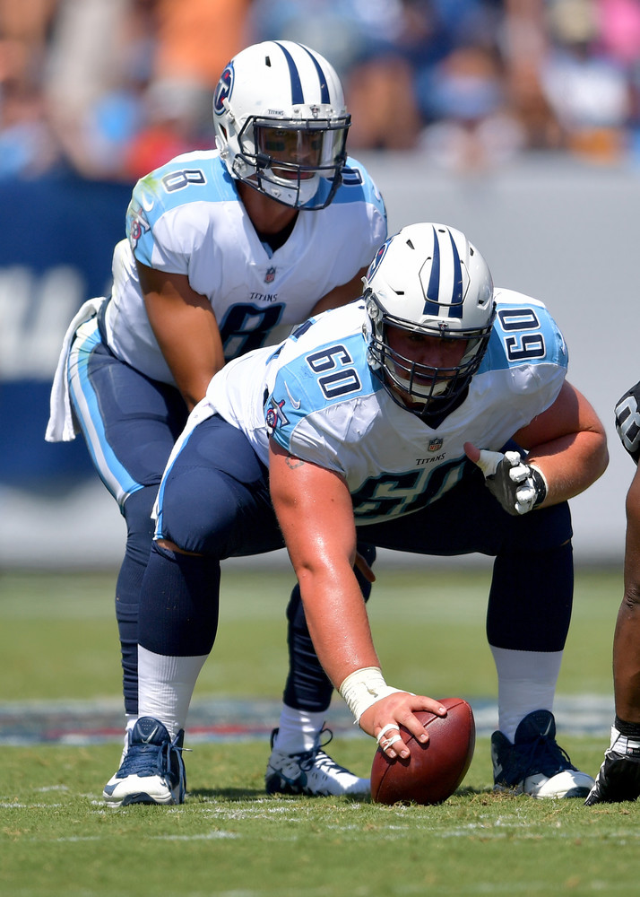 Titans quarterback Marcus Mariota (8) about to take the snap from center Ben Jones (60) during the first half of the Oakland Raiders at Tennessee Titans NFL football game on Sept. 10, 2017, at Nissan Stadium in Nashville, Tenn.