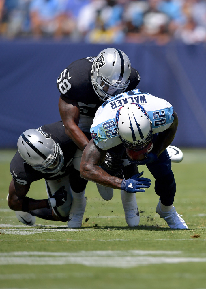 Titans tight end Delanie Walker (82) is tackled after a catch in the first half of the Oakland Raiders at Tennessee Titans NFL football game on Sept. 10, 2017, at Nissan Stadium in Nashville, Tenn.