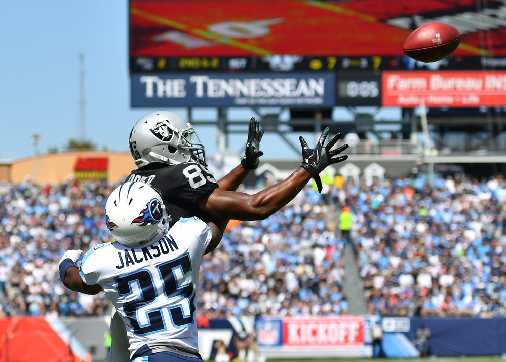 Titans cornerback Adoree' Jackson (25) breaks up a pass intended for Raiders wide receiver Amari Cooper (89) in the first half of the Raiders at Titans NFL football game on Sept. 10, 2017, at Nissan Stadium in Nashville, Tenn.