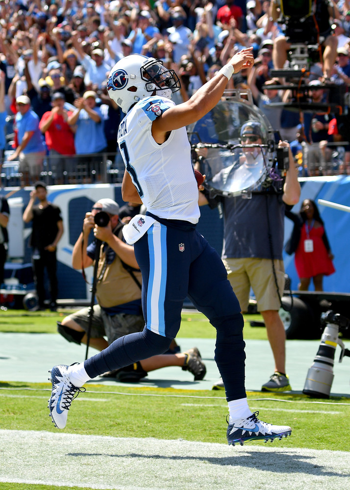 Titans quarterback Marcus Mariota (8) points to the fans after scoring a touchdown in the first half of the Oakland Raiders at Tennessee Titans NFL football game on Sept. 10, 2017, at Nissan Stadium in Nashville, Tenn.