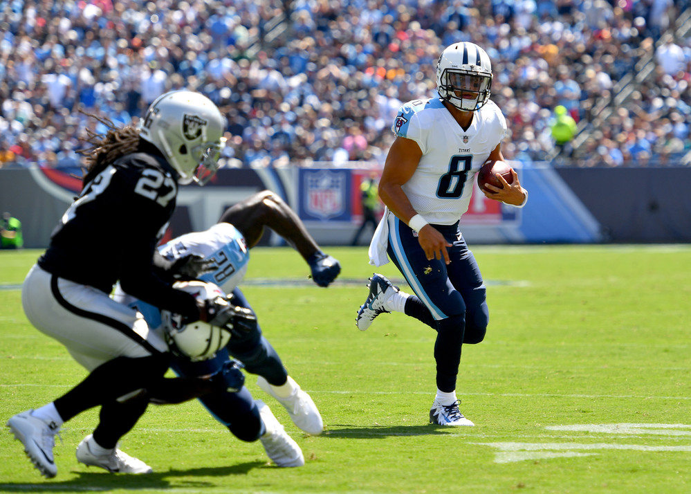 Titans quarterback Marcus Mariota (8) on a run toward a touchdown in the first half of the Oakland Raiders at Tennessee Titans NFL football game on Sept. 10, 2017, at Nissan Stadium in Nashville, Tenn.