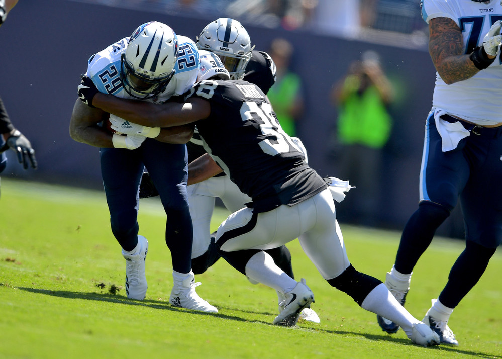 Titans running back DeMarco Murray (29) is tackled by Raiders strong safety Keith McGill (39) in the first half of the Raiders at Titans NFL football game on Sept. 10, 2017, at Nissan Stadium in Nashville, Tenn.