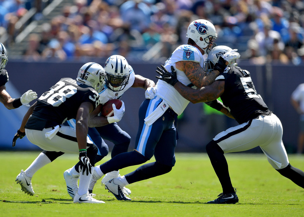 Titans running back DeMarco Murray (29) on a run in the first half of the Oakland Raiders at Tennessee Titans NFL football game on Sept. 10, 2017, at Nissan Stadium in Nashville, Tenn.