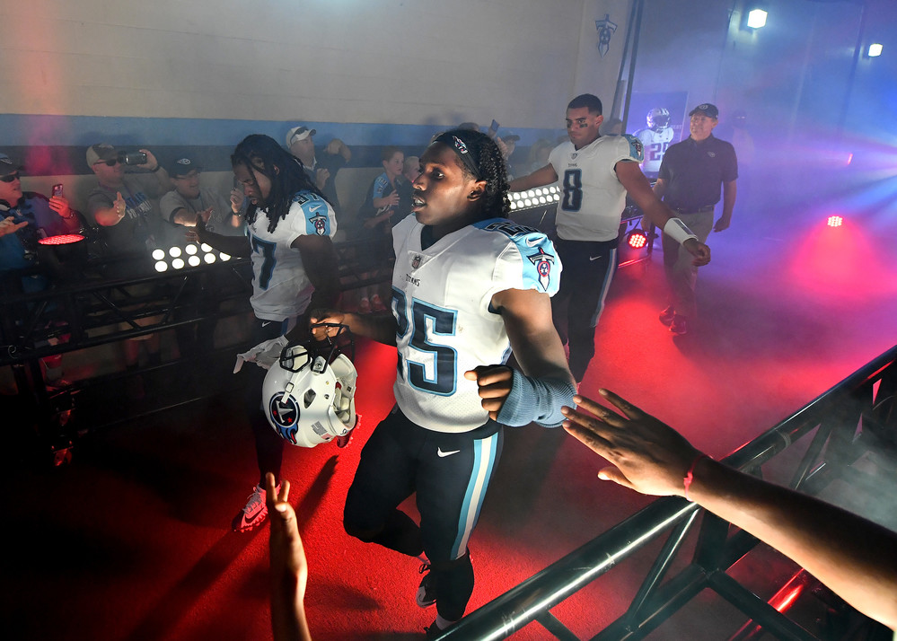 Titans players, including cornerback Adoree' Jackson (25) and Marcus Mariota (8), are greeted by fans as they leave the locker room before the start of the Oakland Raiders at Tennessee Titans NFL football game on Sept. 10, 2017, at Nissan Stadium in Nashville, Tenn.