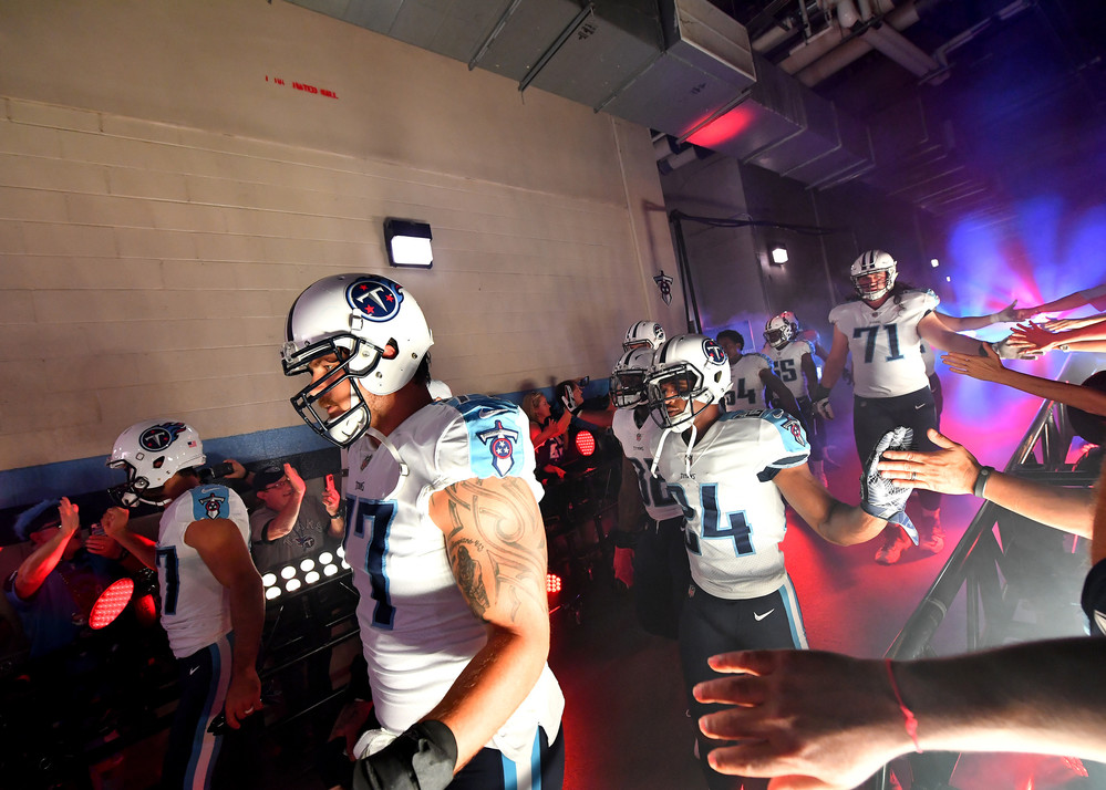 Titans players are greeted by fans as then enter the tunnel prior to the start of the Oakland Raiders at Tennessee Titans NFL football game on Sept. 10, 2017, at Nissan Stadium in Nashville, Tenn.