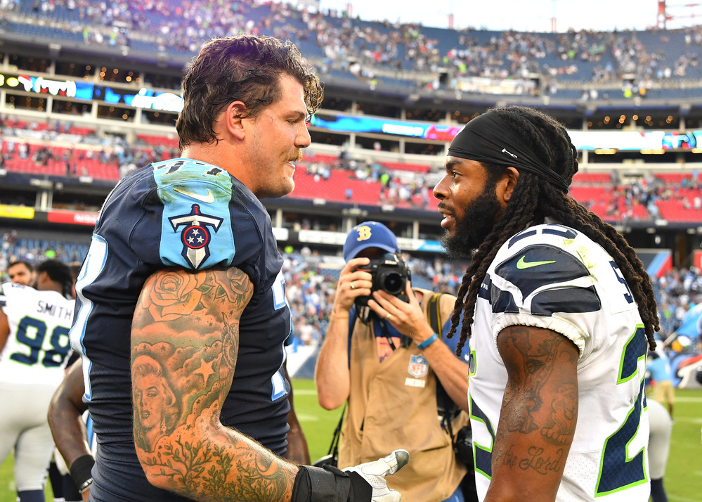 Titans offensive tackle Taylor Lewan (77) and Seahawks cornerback Richard Sherman (25) talk with each other at the end of the Seahawks at Titans NFL football game on Sept. 24, 2017, at Nissan Stadium in Nashville, Tenn. The Titans won 33-27. (Photo by Lee Walls / Walls Media)