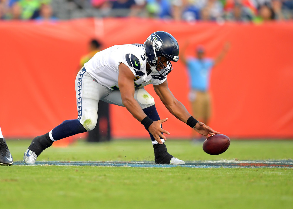Seahawks quarterback Russell Wilson (3) fumbles a snap in the second half of the Seattle Seahawks at Tennessee Titans NFL football game on Sept. 24, 2017, at Nissan Stadium in Nashville, Tenn. The Titans won 33-27. (Photo by Lee Walls / Walls Media)