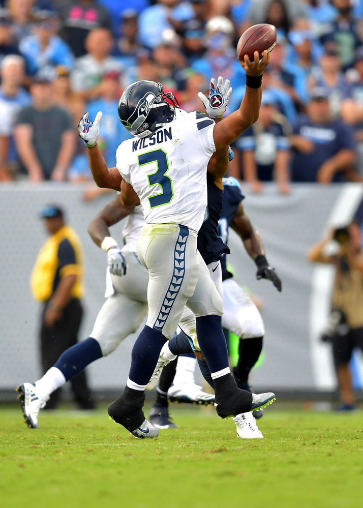 The Titans keep pressure on Seahawks quarterback Russell Wilson (3) during the second half of the Seattle Seahawks at Tennessee Titans NFL football game on Sept. 24, 2017, at Nissan Stadium in Nashville, Tenn. The Titans won 33-27. (Photo by Lee Walls / Walls Media)