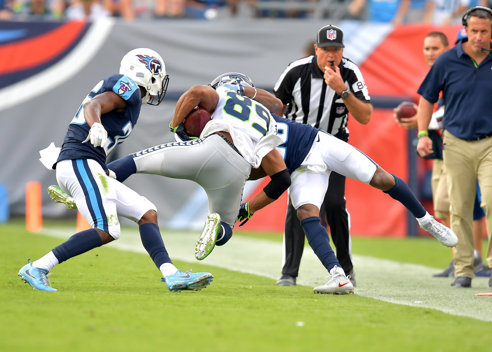 Titans cornerback Logan Ryan (26) tackles Seahawks wide receiver Doug Baldwin (89) during the second half of the Seattle Seahawks at Tennessee Titans NFL football game on Sept. 24, 2017, at Nissan Stadium in Nashville, Tenn. The Titans won 33-27. (Photo by Lee Walls / Walls Media)