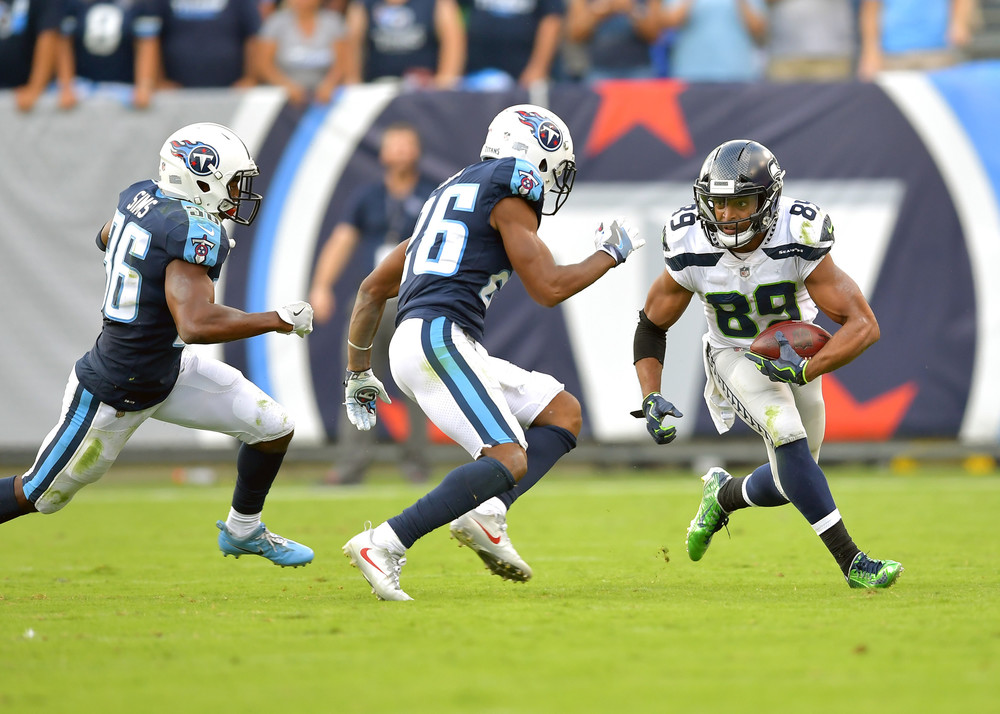 Titans cornerback Logan Ryan (26) prepares to tackle Seahawks wide receiver Doug Baldwin (89) during the second half of the Seattle Seahawks at Tennessee Titans NFL football game on Sept. 24, 2017, at Nissan Stadium in Nashville, Tenn. The Titans won 33-27. (Photo by Lee Walls / Walls Media)