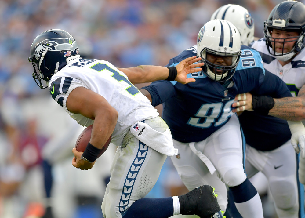 The Titans keep pressure on Seattle Seahawks quarterback Russell Wilson (3) in the second half of the Seahawks at Titans NFL football game on Sept. 24, 2017, at Nissan Stadium in Nashville, Tenn. The Titans won 33-27. (Photo by Lee Walls / Walls Media)