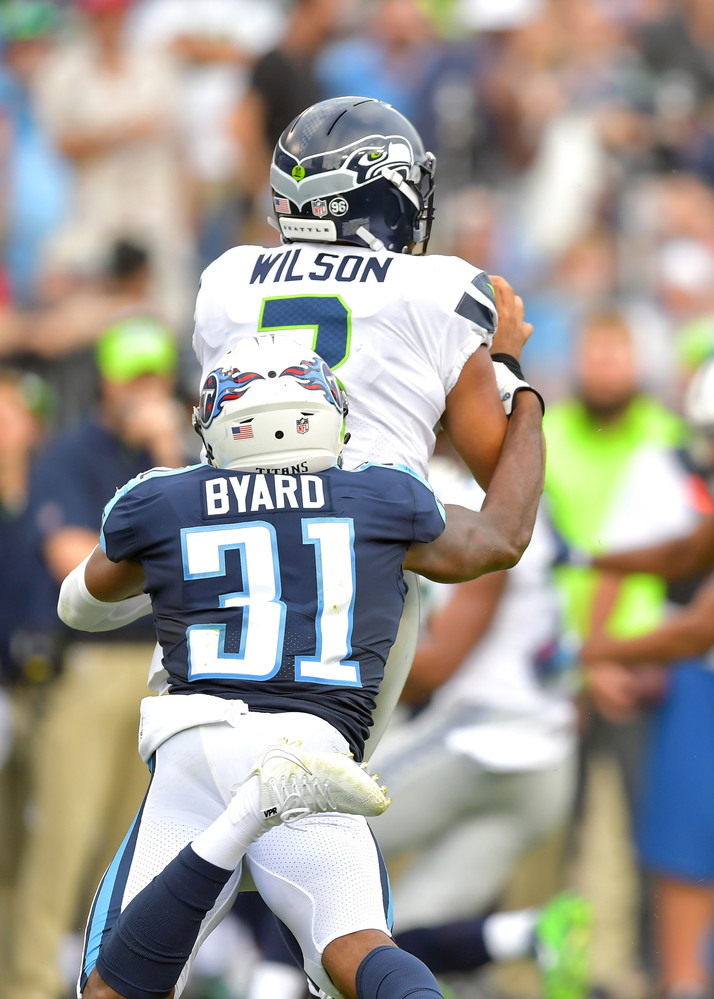 Titans free safety Kevin Byard (31) sacks Seahawks quarterback Russell Wilson (3) in the second half of the Seattle Seahawks at Tennessee Titans NFL football game on Sept. 24, 2017, at Nissan Stadium in Nashville, Tenn. The Titans won 33-27. (Photo by Lee Walls / Walls Media)