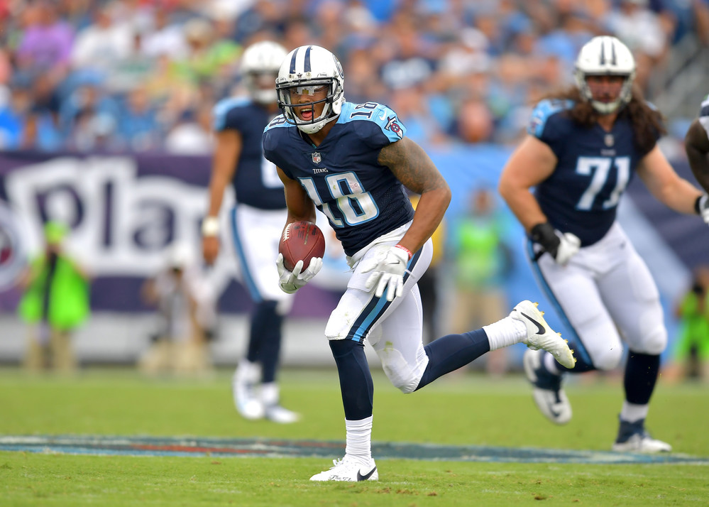 Titans wide receiver Rishard Matthews (18) carries the ball on the way to a touchdown in the second half of the Seattle Seahawks at Tennessee Titans NFL football game on Sept. 24, 2017, at Nissan Stadium in Nashville, Tenn. The Titans won 33-27. (Photo by Lee Walls / Walls Media)