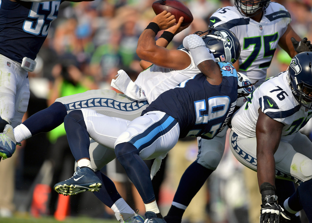 Tennessee Titans outside linebacker Kevin Dodd (93) tackles Seattle Seahawks quarterback Russell Wilson (3) during the first half of the Seahawks at Titans NFL football game on Sept. 24, 2017, at Nissan Stadium in Nashville, Tenn. (Photo by Lee Walls)
